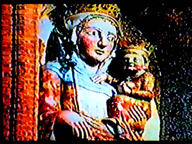 Fig. #C2b: One frame from an old film showing the stucco statue of Virgin Mary from the Malbork Castle, together with the place where it used to stand.